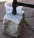 Crushing grit with a hammer