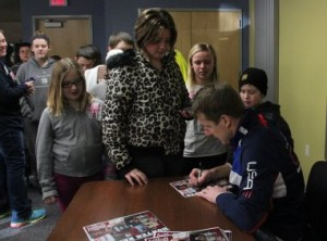 Hunter signing one of many autographs at Fuller Hall Recreation center.